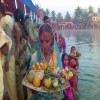 Women giving aragh on Chhath Puja